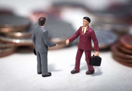 Two small buisness men making a deal