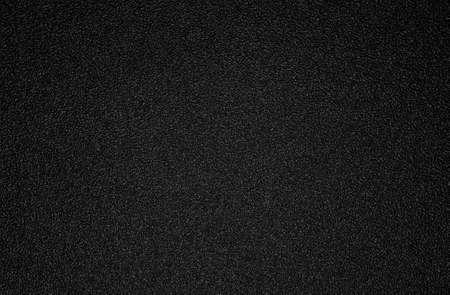 Achtergrond schot van zwarte plastic textuur