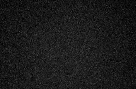 Background shot of black plastic texture