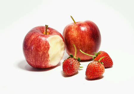 closeup: Red apples and Strawberries on white background Stock Photo