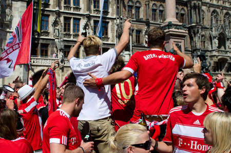 Germany, Munich - 19 May 2012: Thousands of fans celebrate in central Munich on the Marienplatz before the UEFA Champions League final football match between FC Bayern Muenchen and Chelsea FC Stock Photo - 13686280
