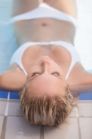 Relaxing in pool. Top view of beautiful young women relaxing in pool with her eyes closed photo