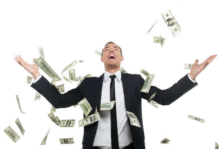 Business successful. Happy young man in formalwear standing isolated on white while money falling at him photo