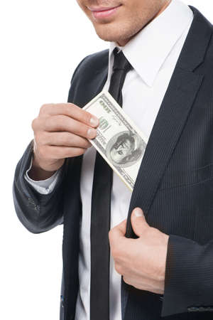 bribing: Bribe. Close-up of businessman taking bribe while isolated on white