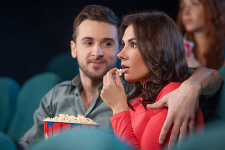 Couple at the cinema. Beautiful young couple watching movie at the cinema Stock Photo - 21986215