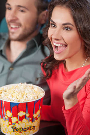 Happy couple at the cinema. Top view of cheerful young couple watching movie at the cinema Stock Photo - 21986216