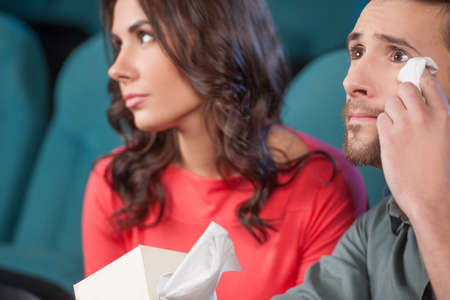 What a wonderful movie! Young couple watching movie at the cinema Stock Photo - 21986217