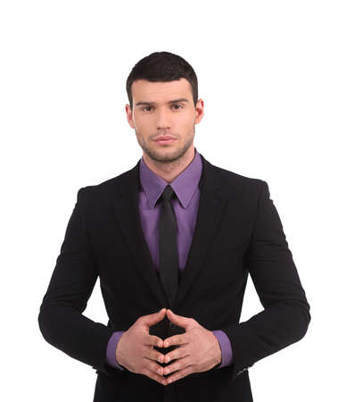 Confident businessman. Confident young man in formalwear holding his hands clasped and looking at camera while isolated on white photo