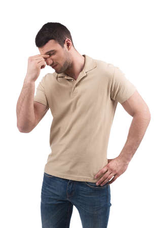 depressed man: Frustrated man. Depressed young men keeping his eyes closed while standing isolated on white