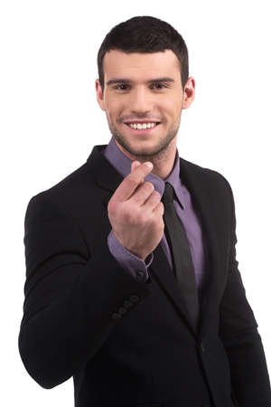only man: Businessman gesturing. Confident young man in formalwear gesturing while isolated on white