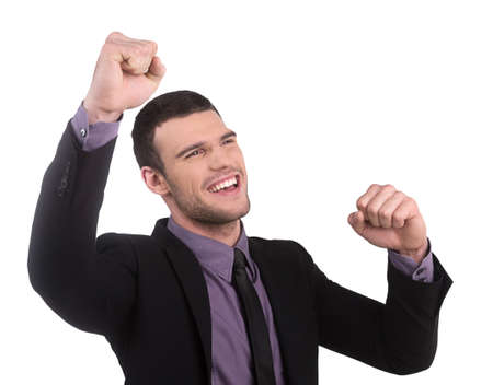 Yes! Happy young businessman gesturing while isolated on white background photo
