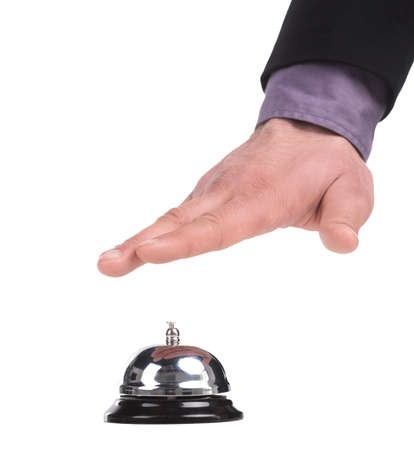 service bell: Service bell. Close-up of man holding hand upon the service bell while isolated on white