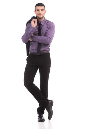 Confident businessman. Full length of confident young man in formalwear looking at camera while isolated on white photo