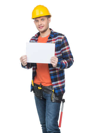 Handyman. Confident young handymen in hardhat holding poster while standing isolated on white Stock Photo - 22016738