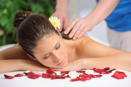 day spa: Massage Hot Mineral Stone Treatment at Day Spa by Masseuse