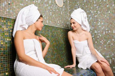 turkish woman: Two beautiful girls talking in Turkish sauna Stock Photo