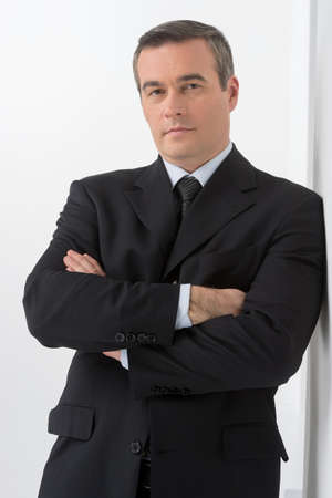 50s adult: Confident businessman. Confident middle-age man in formalwear looking at camera Stock Photo
