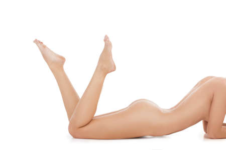 naked female body: Naked woman. Cropped image of young naked women lying on front while isolated on white Stock Photo