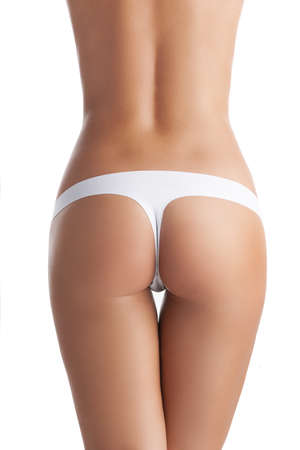 Female buttocks. Rear view of female buttocks isolated on white photo