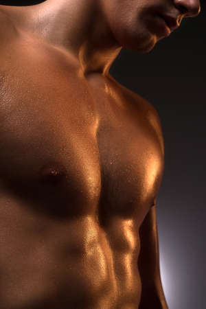 male torso: Muscular man. Close-up of muscular man standing isolated on white