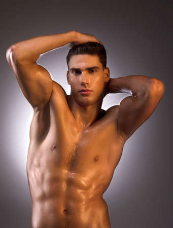 muscular man: Muscular man. Muscular man posing while standing isolated on white Stock Photo