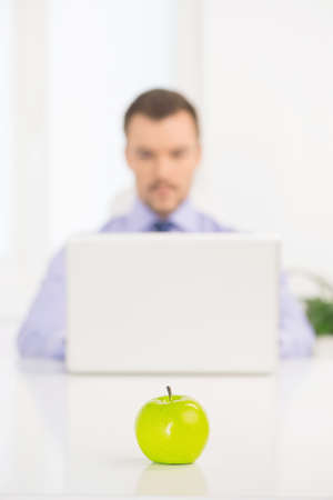 businessman working at his computer: Businessman at work. Confident young man in formalwear working at the computer while sitting at his working place Stock Photo