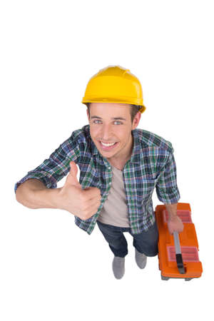 Handyman. Top view of cheerful craftsperson looking at camera and holding his thumb up while isolated on white Stock Photo - 22456904