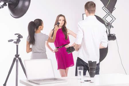studio photo: Fashion model at studio. Beautiful young female fashion model posing at photo studio