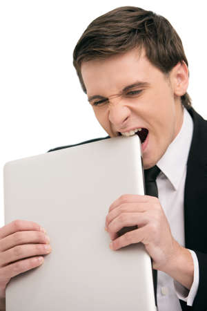 Man bites laptop with emotions photo