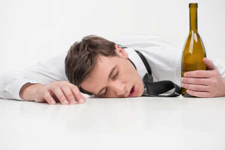 Man falls asleep after getting drunk photo