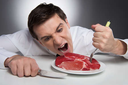 steak plate: Hungry man can not wait till meat is cooked Stock Photo