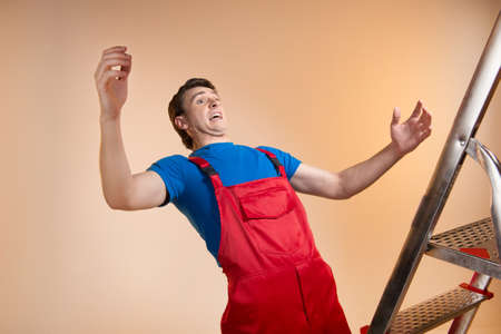 Man is falling down from a ladder Stock Photo - 22550036