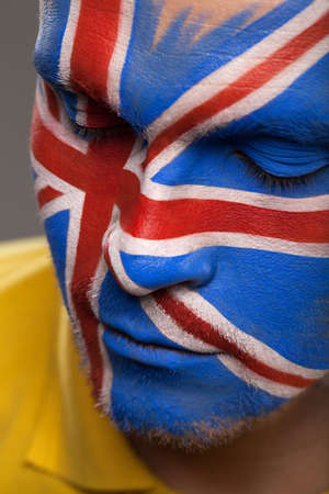 rooting: Painted face with Flag of Great Britain. Close-up with closed eyes