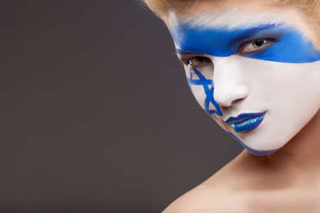 flag of israel: Painted face. Face art on beautiful girl face