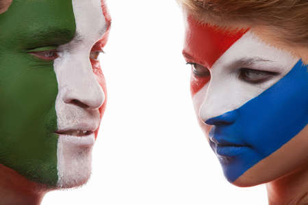 Close up of face art. Couple with painted faces look at each other photo