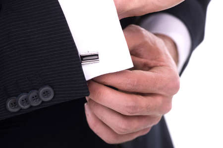 cufflinks: Close up of businessman wearing cufflinks. Isolated on white