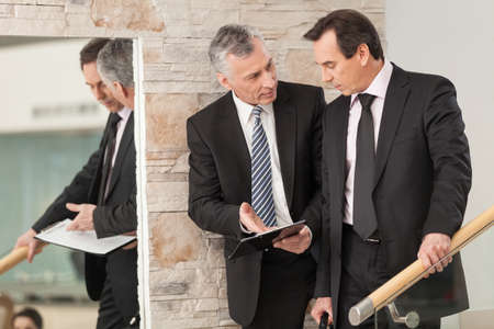 only men: Two corporate professionals having discussion