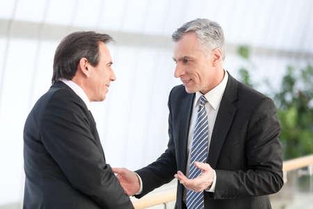 mature businessman: Portrait of  two mature businessman at office Stock Photo
