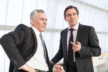 mature businessman: Two mature businessman at office