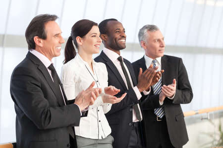 Professional business team applauding photo