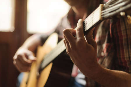 playing the guitar: Creativity in focus. Close-up of men playing acoustic guitar Stock Photo