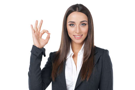 Happy smiling businesswoman with okay gesture. Isolated on white photo
