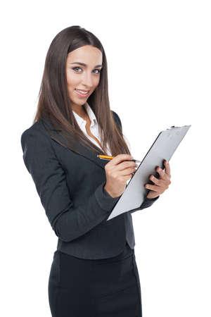 plane table: Sonriente mujer de negocios escribir algo sobre la plancheta. Pie aislado en blanco