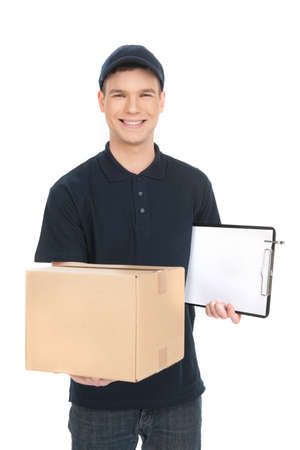 Cheerful deliveryman. Cheerful young deliveryman holding a cardboard box while isolated on white