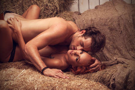Nude sexy couple having sex. Laying in hayloft