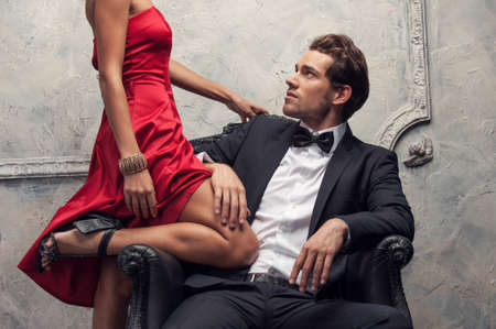 sexy young man: Elegant couple passing in classic clothes. Close up, cut shoot Stock Photo