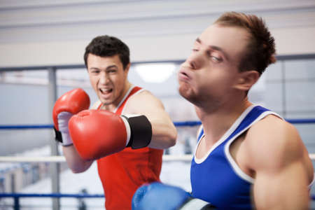 punched: Men boxing. Two boxers fighting on the boxing ring