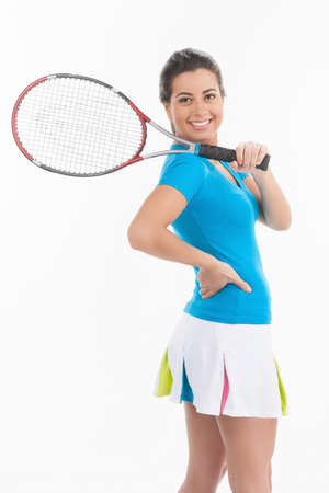 tennis skirt: Ready for tennis game. Rear view of young beautiful women in tennis skirt holding a tennis racket and looking over shoulder while standing isolated on white