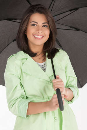 woman umbrella: Beautiful women with umbrella. Attractive young women holding an umbrella and smiling at camera while isolated on white Stock Photo