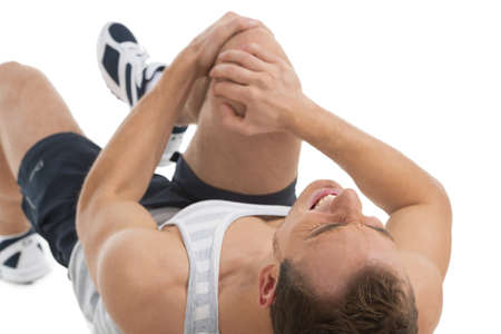 dislocation: Man feeling pain in his knee. While laying on his back